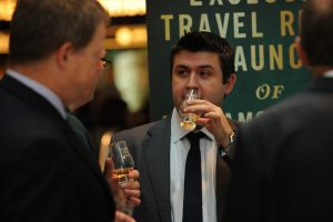 Andre de Almeida drinking whisky